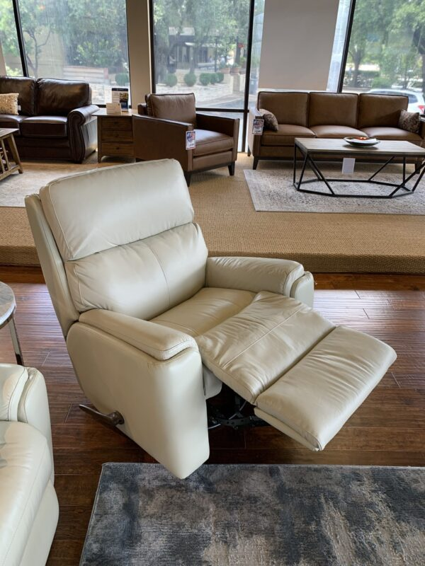 Rio's traditional frame is highlighted with subtle back wings and inset padded armrests that peek up for an interesting appeal. Its divided back cushion provides support all the way from your neck down to your lumbar region for full support. A power rocking reclining mechanism lets you rock and change angles effortlessly from an upright to a fully reclined position with the touch of a button.