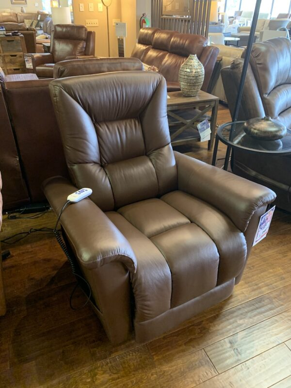 "A classic with a contemporary flair, the Whiteshell lift recliner is like no other. The well-defined seating and back details feature a luxurious memory foam, perfect for those who sit for long periods of time. With pillow top foam arms and a deeply channeled seat and back cushion, the Whiteshell offers irresistible comfort. The power lift mechanism gently guides you to a comfortable standing position, alleviating any pressure on the joints and muscles. For added convenience, there is an outside pocket to keep the remote and your belongings within arms reach. An extended footrest offers additional support when lounging or watching television in a fully reclined position. A two motor layflat mechanism enables the occupant to fully recline to an almost flat position, while the two motors allow for independent operation of the footrest and back recline for perfect individualized comfort. The wand also features a handy ""home"" button to return the chair to a fully closed position and built in USB charging. Loaded with function and comfort the Whiteshell is the perfect choice."